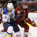 St. Louis Blues' T.J. Oshie (74) battles Arizona Coyotes' Oliver Ekman-Larsson (23), of Sweden, for a loose puck during the first period of an NHL hockey game Tuesday, Jan. 6, 2015, in Glendale, Ariz The Associated Press