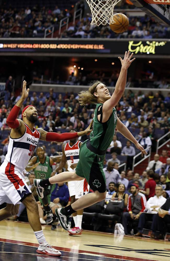Boston Celtics center Kelly Olynyk (41) shoots in front of Washington Wizards forward Drew Gooden (90) during the first half of an NBA basketball game Wednesday, April 2, 2014 in Washington