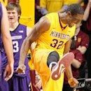Minnesota forward Trevor Mbakwe (32) celebrates a basket while Northwestern guard Kale Abrahamson looks on during the first half of an NCAA college basketball game, Sunday, Jan. 6, 2013, in Minneapolis. (AP Photo/Andy King)