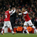 Arsenal s Theo Walcott, right, comes on as a substitute for Santi Cazorla, left, after his injury layoff during the English Premier League soccer match between Arsenal and Southampton at the Emirates Stadium in London, Saturday, Nov. 23, 2013