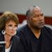 Defense attorney Patricia Palm, left, and O.J. Simpson appear at an evidentiary hearing in Clark County District Court on May 17, 2013 in Las Vegas. Simpson, who is currently serving a nine-to-33-year sentence in state prison as a result of his October 2008 conviction for armed robbery and kidnapping charges, is using a writ of habeas corpus to seek a new trial, claiming he had such bad representation that his conviction should be reversed.  (AP Photo/Ethan Miller, Pool)