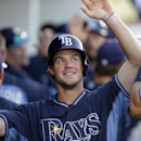 Tampa Bay Rays' Wil Myers celebrates in the dugout after scoring on a two-run double by James Loney in the first inning of an exhibition baseball game against the Minnesota Twins in Fort Myers, Fla., Tuesday, March 18, 2014 The Associated Press