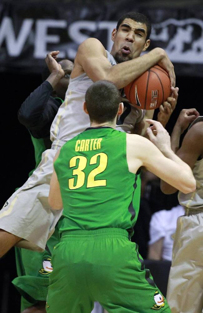 Colorado forward Josh Scott, back, pulls in a rebound as Oregon forward Ben Carter covers in the first half of an NCAA college basketball game, Sunday, Jan. 5, 2014, in Boulder, Colo