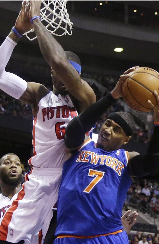 New York Knicks forward Carmelo Anthony (7) is blocked by Detroit Pistons forward Josh Smith (6) during the first half of an NBA basketball game in Auburn Hills, Mich., Tuesday, Nov. 19, 2013