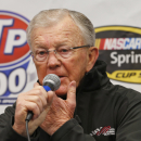 Nascar team owner Joe Gibbs, addresses the media about the condition of his son J.D. Gibbs in the media center prior to the start of the NASCAR Sprint Cup race at the Martinsville Speedway in Martinsville, Va., Sunday, March 29, 2015. Joe Gibbs Racing President J.D. Gibbs is undergoing treatment for