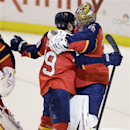 Florida Panthers' Scottie Upshall (19) and goalie Jacob Markstrom (35) celebrate after defeating the New York Rangers 3-2 in