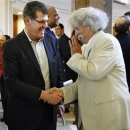 Connecticut head coach Geno Auriemma, left, shakes hand with William Clement during an induction ceremony into the state's Hall of Fame at the Legislative Office Building in Hartford, Conn., Wednesday, April 24, 2013. Auriemma was inducted on Wednesday along with former Connecticut men's head coach Jim Calhoun, Roger Sherman, a founding father who helped draft the Declaration of Independence, and toy maker A.C. Gilbert, known for creating the erector set. (AP Photo/Jessica Hill)