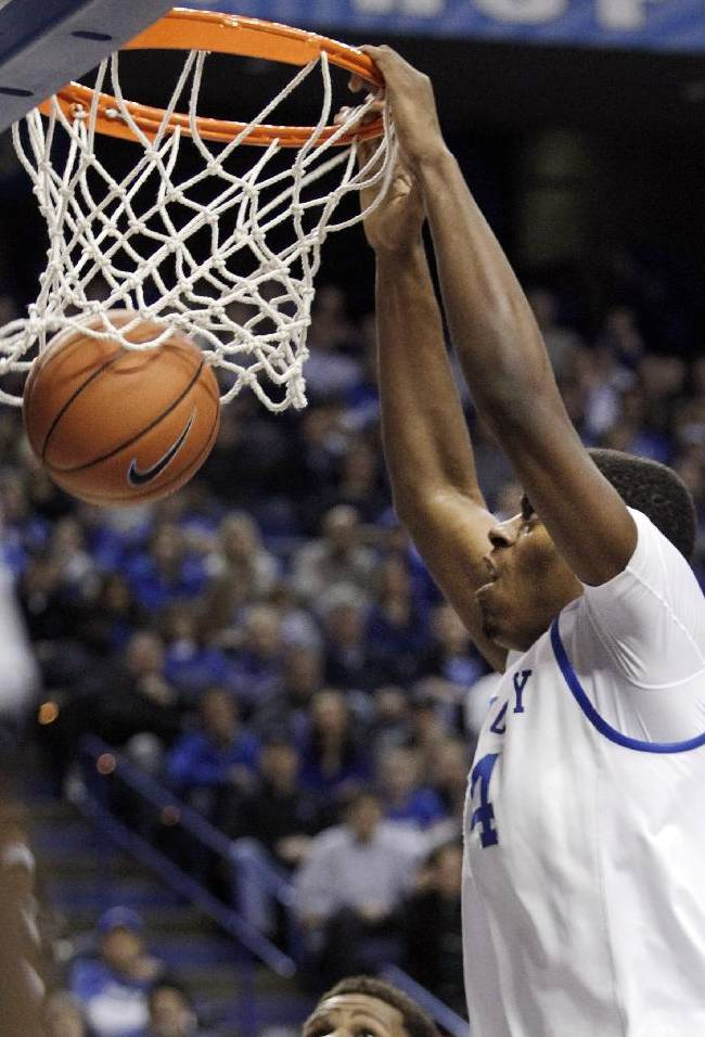 Kentucky's Dakari Johnson dunks during the first half of an NCAA college basketball game against Texas A&M, Tuesday, Jan. 21, 2014, in Lexington, Ky