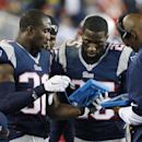 New England Patriots defensive backs Devin McCourty (32) and Kyle Arrington (25) study a tablet device on the sideline in the second half of an NFL football game against the New York Jets on Thursday, Oct. 16, 2014, in Foxborough, Mass The Associated Pres