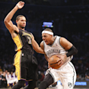 Brooklyn Nets small forward Paul Pierce, right, drives against Los Angeles Lakers small forward Xavier Henry (7) in the second quarter of an NBA basketball game at the Barclays Center, Wednesday, Nov. 27, 2013, in New York The Associated Press