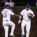 Chicago Cubs shortstop Starlin Castro, left, and left fielder Ryan Kalish celebrate after they defeated the Arizona Diamondbacks 5-1 in a baseball game on Monday, April 21, 2014, in Chicago The Associated Press