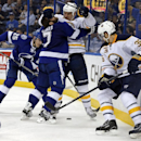 Tampa Bay Lightning's Radko Gudas (7), of the Czech Republic, is checked by Buffalo Sabres' Cody McCormick (8) as the Lightning's Matt Carle (25) and Sabres Patrick Kaleta (36) look for the loose puck during the third period of an NHL hockey game Thursday