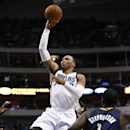 Dallas Mavericks small forward Shawn Marion (0) shoots the ball in front of Indiana Pacers' Lance Stephenson (1) 2during the first half of an NBA game, Sunday, Mar. 9, 2014, in Dallas, Texas The Associated Press