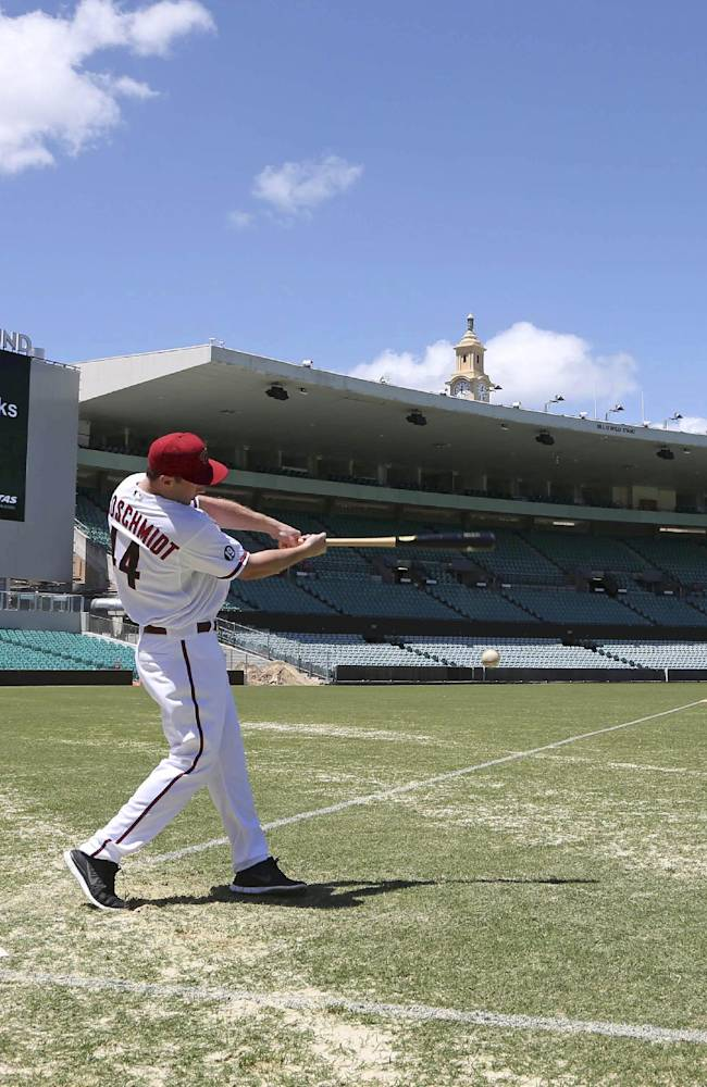 Major League Baseball player Paul Goldschmidt, from the Arizona Diamondbacks, hits a ball at the Sydney Cricket Ground in Sydney, Monday, Nov. 4, 2013. Major League Baseball will launch their 2014 season with the Diamondbacks playing the Los Angeles Dodgers with a 2-game series on March 22-23