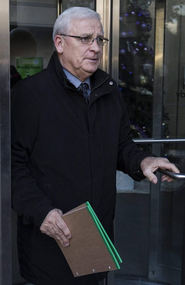 Ottawa Senators general manager Bryan Murray leaves following NHL general managers' meetings in Toronto, Tuesday, Nov. 12, 2013
