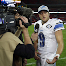 Detroit Lions quarterback Matthew Stafford (9) talks to a reporter after the NFL football game against the Atlanta Falcons at Wembley Stadium, London, Sunday, Oct. 26, 2014. The Lions won 22-21 The Associated Press