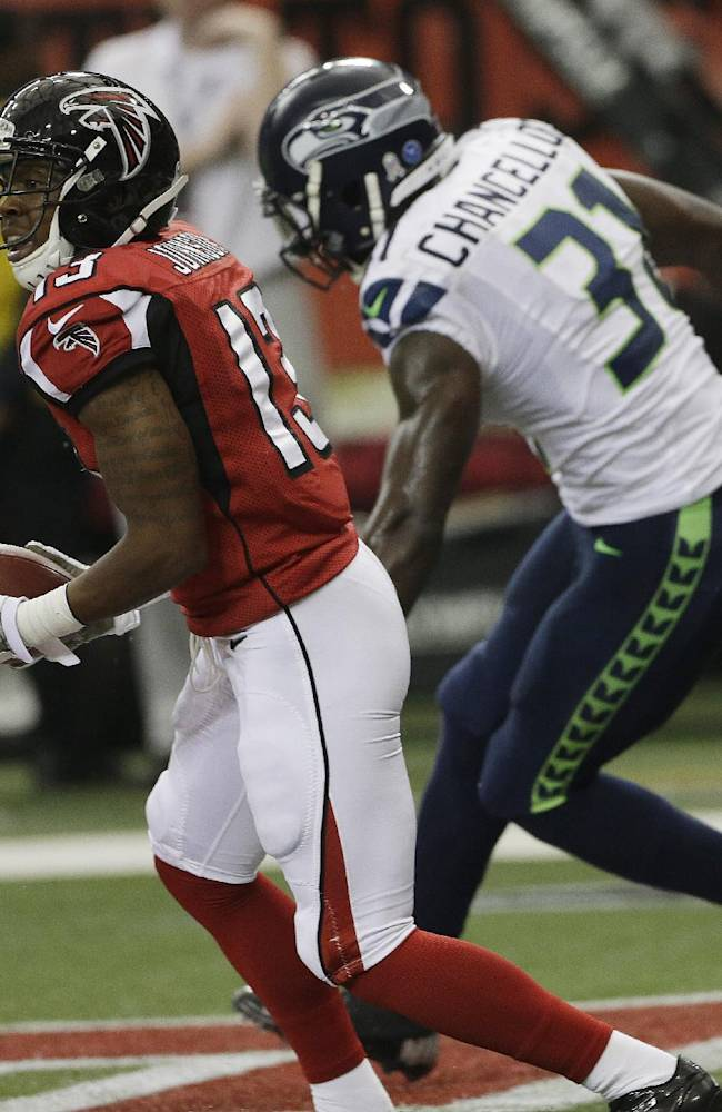 Atlanta Falcons wide receiver Darius Johnson (13) runs into the end zone for a touchdown against Seattle Seahawks strong safety Kam Chancellor (31) during the second half of an NFL football game, Sunday, Nov. 10, 2013, in Atlanta