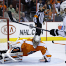 Philadelphia Flyers' Ray Emery, left, cannot block a shot by Los Angeles Kings' Dwight King during the third period of an NHL hockey game, Monday, March 24, 2014, in Philadelphia. Los Angeles won 3-2 The Associated Press