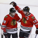 In this March 6, 2014 file photo, Chicago Blackhawks center Jonathan Toews (19) celebrates his goal with Patrick Kane during the third period of an NHL hockey game against the Columbus Blue Jackets in Chicago. A changing of the guard appears to be in stor