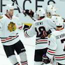 Chicago Blackhawks' Jonathan Toews, center, celebrates his first-period goal with teammates as Ben Smith, left, comes to join in during NHL hockey game action against the Ottawa Senators in Ottawa, Ontario, Thursday, Oct. 30, 2014 The Associated Press