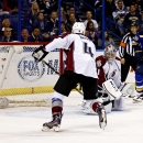 Colorado Avalanche goalie Semyon Varlamov, of Russia, looks over his shoulder at a goal scored by St. Louis Blues' Carl Gunnarsson, not pictured, of Sweden, as the Avalanches Tyson Barrie (4) and Blues' Paul Stastny (26) look on during the first period of