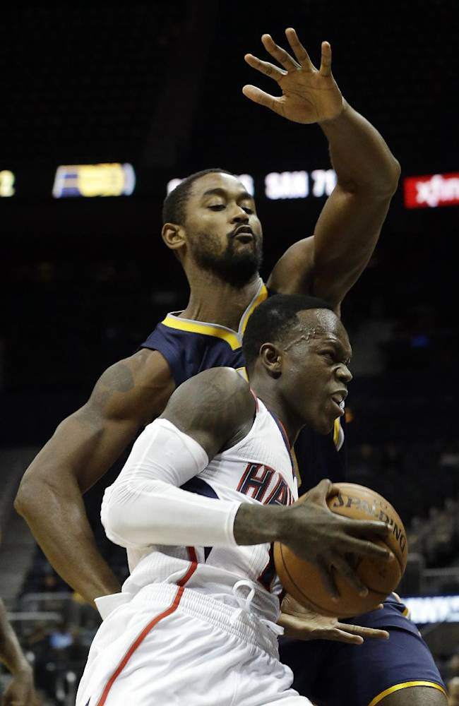 Atlanta Hawks point guard Dennis Schroder (17), of Germany, drives past Indiana Pacers power forward Hilton Armstrong (29) during the second half of a preseason NBA basketball game Tuesday, Oct. 22, 2013, in Atlanta