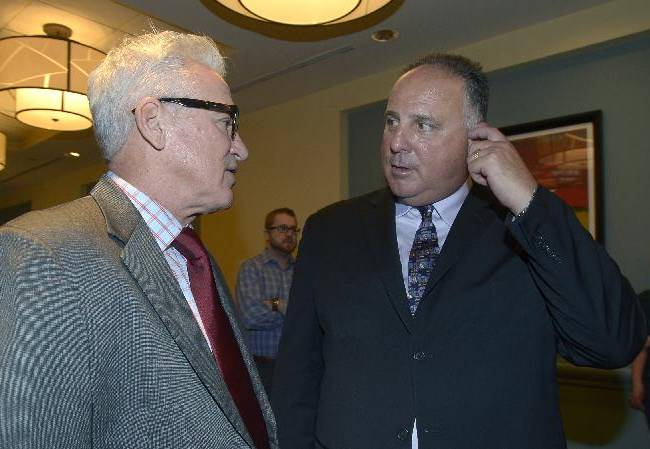 Tampa Bay Rays manager Joe Maddon , left, chats with Los Angeles Angels manager Mike Scioscia at baseball's winter meetings in Lake Buena Vista, Fla., Wednesday, Dec. 11, 2013