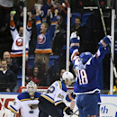 New York Islanders center Ryan Strome (18) celebrates his goal as St. Louis Blues goalie Jake Allen (34) and defenseman Kevin Shattenkirk (22) react during the first period of an NHL hockey game at Nassau Coliseum on Saturday, Dec. 6, 2014, in Uniondale,