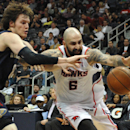 New Orleans Pelicans' Luke Babbitt, left, and Atlanta Hawks' Pero Antic (6) try to regain control of the ball in the second half of an NBA basketball game Friday, March 21, 2014, in Atlanta. New Orleans won 111-105 The Associated Press