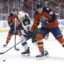 Minnesota Wild left wing Jason Zucker (16) and Florida Panthers defenseman Erik Gudbranson (44) go for the puck during the first period of an NHL hockey game, Monday, Nov. 24, 2014, in Sunrise, Fla The Associated Press