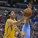 Indiana Pacers forward Luis Scola, left, of Argentina, puts up a shot as Los Angeles Clippers center Ryan Hollins defends during the first half of an NBA basketball game, Sunday, Dec. 1, 2013, in Los Angeles The Associated Press