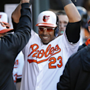 In this March 31, 2014 file photo, Baltimore Orioles' Nelson Cruz high-fives teammates in the dugout after hitting a solo home run in the seventh inning of an opening day baseball game against the Boston Red Sox, in Baltimore. They were labeled cheaters a