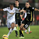Swansea City's Wayne Routledge, left, and Tottenham Hotspur's Nabil Bentaleb, in action during their English Premier League soccer match at the Liberty Stadium, Swansea, Sunday Dec. 14, 2014. (AP Photo / Nick Potts, PA)