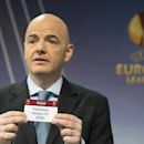 UEFA General Secretary Gianni Infantino, shows a ticket with British soccer team Tottenham Hotspur FC during the draw of the round of 32 of the UEFA Europa League 2014/15 at the UEFA Headquarters, in Nyon, Switzerland, Monday, Dec.15, 2014