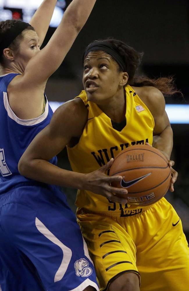 Wichita State's Michelle Price, right, looks to the basket as Drake's Kyndal Clark defends during the first half of an NCAA college basketball game in the championship of the Missouri Valley Conference women's tournament on Sunday, March 16, 2014, in St. Charles, Mo