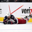 Columbus Blue Jackets center Artem Anisimov, of Russia, dives for the puck during the third period of an NHL hockey game, Sunday, Oct. 26, 2014, in Los Angeles. The Kings won 5-2 The Associated Press