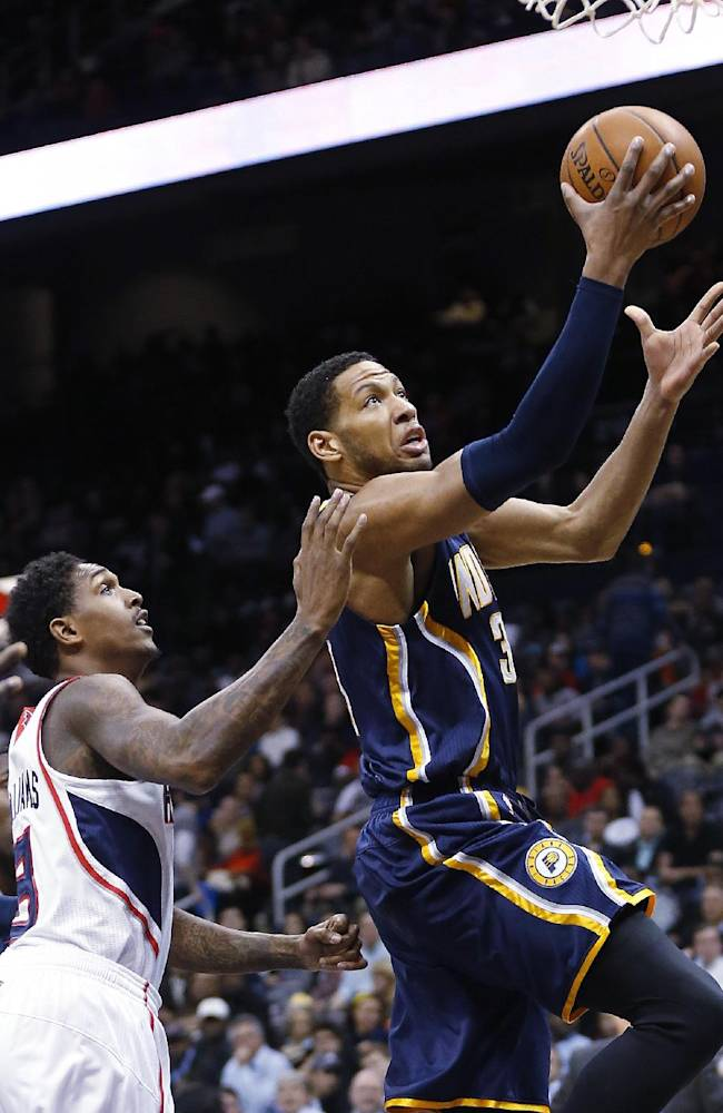 Indiana Pacers small forward Danny Granger (33) drives to the basket as Atlanta Hawks shooting guard Louis Williams (3) defends in the first  half of an NBA basketball game, Tuesday, Feb. 4, 2014, in Atlanta