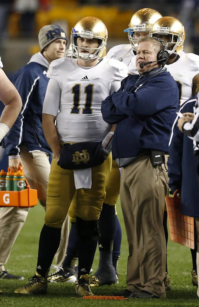 Notre Dame quarterback Tommy Rees (11) talks with head coach Brian Kelly during a time out in the fourth quarter of an NCAA college football game against Pittsburgh on Saturday, Nov. 9, 2013, in Pittsburgh. Pittsburgh won 28-21