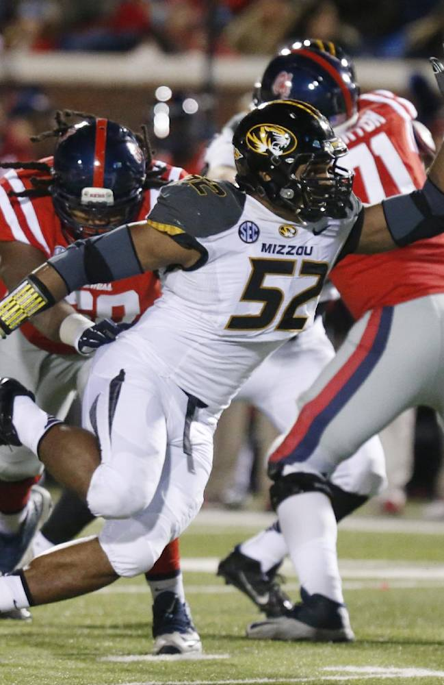 In this Nov. 23, 2013 file photo, Missouri defensive lineman Michael Sam (52) pushes past a block by Mississippi offensive linesman Pierce Burton (71) in the second half of a NCAA college football game in Oxford, Miss. Michael Sam hopes his ability is all that matters, not his sexual orientation.  Missouri's All-America defensive end came out to the entire country Sunday night, Feb. 9, 2014, and could become the first openly gay player in America's most popular sport