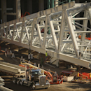 During a tour of the Vikings stadium Monday, Oct. 20, 2014, a construction worker touched up the paint on the ridge truss, the single heaviest component that will be lifted into place by a crane. Nine months after the old Metrodome was demolished, offic