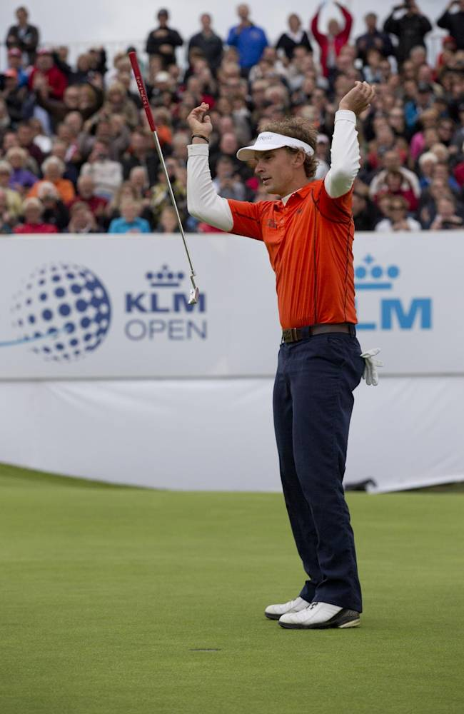 Joost Luiten of The Netherlands celebrates winning the KLM Open men's golf tournament in the beach resort of Zandvoort, western Netherlands, Sunday, Sept. 15, 2013
