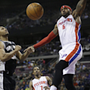 Detroit Pistons forward Josh Smith (6) reacts after a dunk on San Antonio Spurs forward Boris Diaw (33) during the second half of an NBA basketball game in Auburn Hills, Mich., Monday, Feb. 10, 2014 The Associated Press