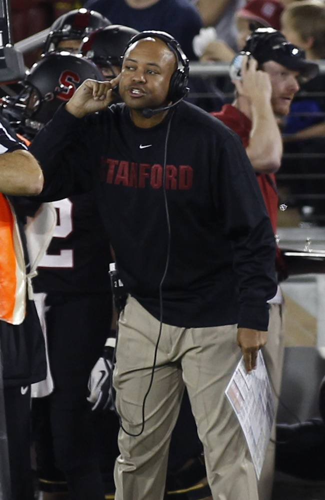 Stanford head coach David Shaw gestures during the first half of an NCAA college football game against Washington in Stanford, Calif., Saturday, Oct. 5, 2013