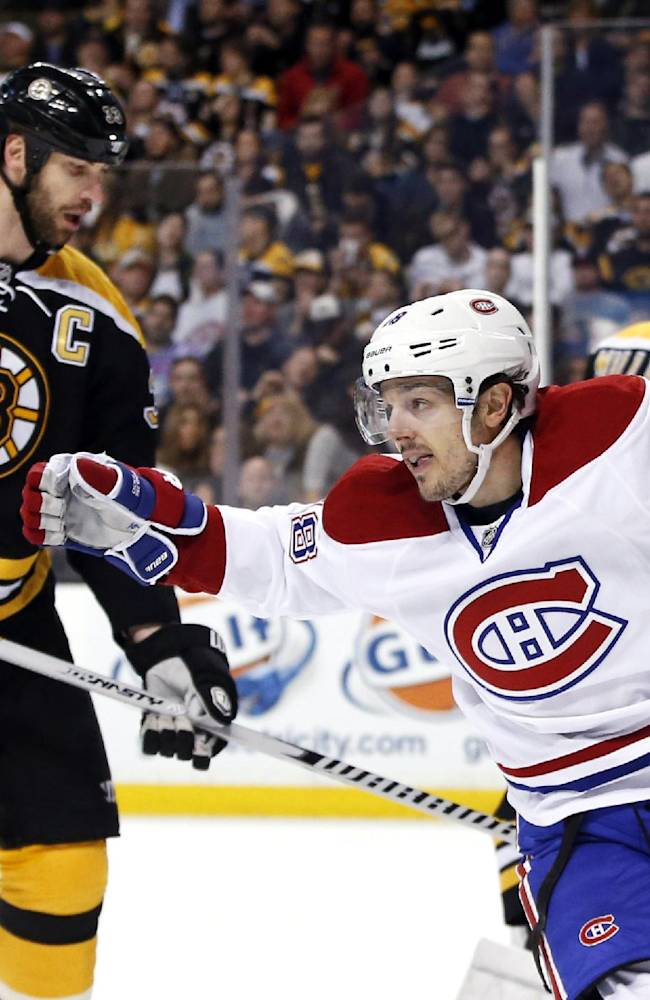 Montreal Canadiens center Daniel Briere (48) celebrates a goal by teammate P.K. Subban as Boston Bruins defenseman Zdeno Chara (33) is near during the first period in Game 1 of an NHL hockey second-round playoff series in Boston, Thursday, May 1, 2014