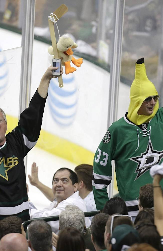 Dallas Stars fans cheer during the second period of Game 6 of a first-round NHL hockey playoff series against the Anaheim Ducks in Dallas, Sunday, April 27, 2014