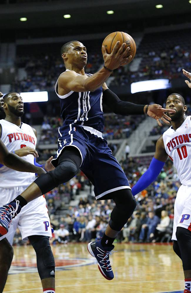 Oklahoma City Thunder guard Russell Westbrook, center, drives against the Detroit Pistons in the first half of an NBA basketball game in Detroit, Friday, Nov. 8, 2013