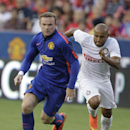 Manchester United's Wayne Rooney, front moves the ball as Inter Milan's Jonathan, right, defends during the first half of a soccer game at the 2014 Guinness International Champions Cup, Tuesday, July 29, 2014, in Landover, Md. Manchester United won 5-3