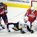 Pittsburgh Penguins left wing James Neal (18) gets tangles up with Washington Capitals defenseman John Carlson (74) as Capitals goalie Jaroslav Halak (41), of Slovakia, looks on during the third period of an NHL hockey game, Monday, March 10, 2014, in Was