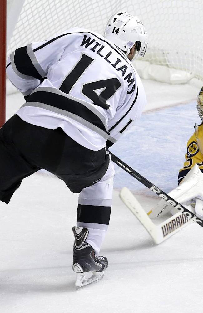Nashville Predators goalie Pekka Rinne (35), of Finland, blocks a shot by Los Angeles Kings right wing Justin Williams (14) during the third period of an NHL hockey game Thursday, Oct. 17, 2013, in Nashville, Tenn. The Kings won 2-1 in a shootout