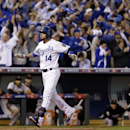 Kansas City Royals' Omar Infante celebrates after hitting a two-run home run during the sixth inning of Game 2 of baseball's World Series against the San Francisco Giants Wednesday, Oct. 22, 2014, in Kansas City, Mo. (AP Photo/David J. Phillip)